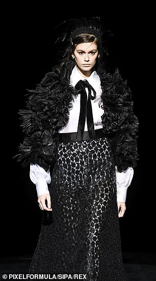 Beach-born beauty: The Malibu-born starlet strut in a ruffled jacket, white top with black string tie, and black lace skirt