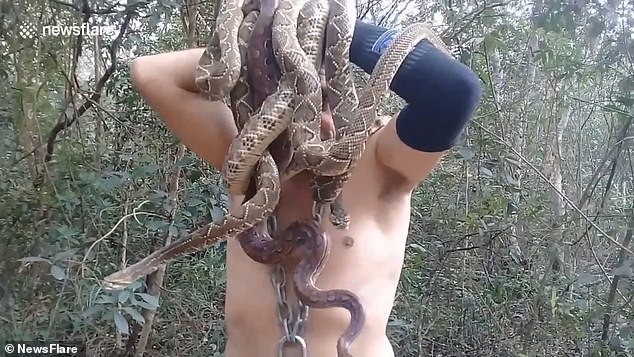 The Brazilian environmental activist was recently was filmed biting on six snakes to protest the Amazon's deforestation. He would then top the stunt off by placing all of the snakes on his head