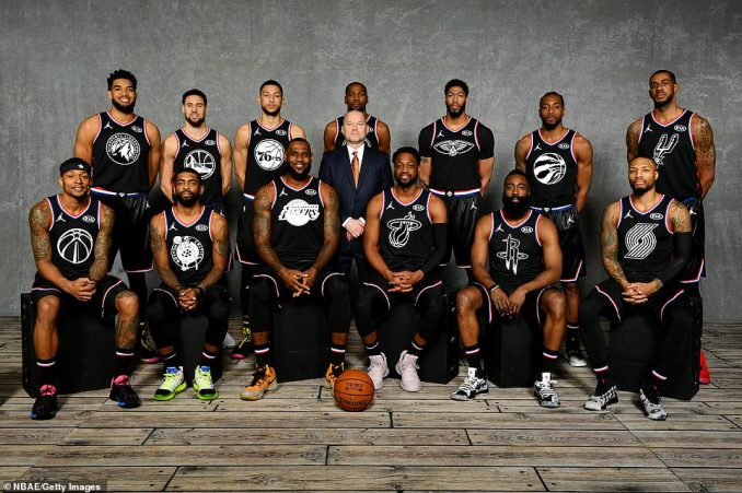 James (third from left on bottom row) poses with his team ahead of the NBA All Star game in Charlotte - Bottom row: Beal, Irving, James, Wade, Harden, Lillard - Top row: Towns, Thompson, Simmons, Durant, Coach Michael Malone, Davis, Leonard and Aldridge