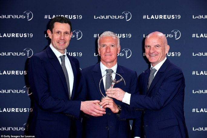 Didier Deschamps (C) alongside coaches Franck Raviot (L) and Guy Stephanon (R) after winning Team of the Year