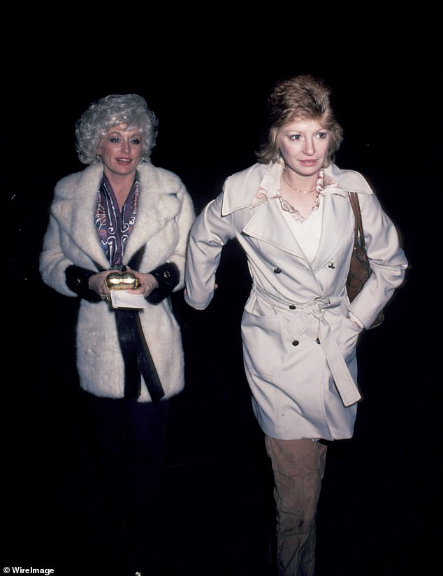 Nothing to see here: Dolly Parton has denied she's gay after years of speculation, as she slams gossips who claimed her best friend Judy Ogle is her secret girlfriend (pictured in 1980)
