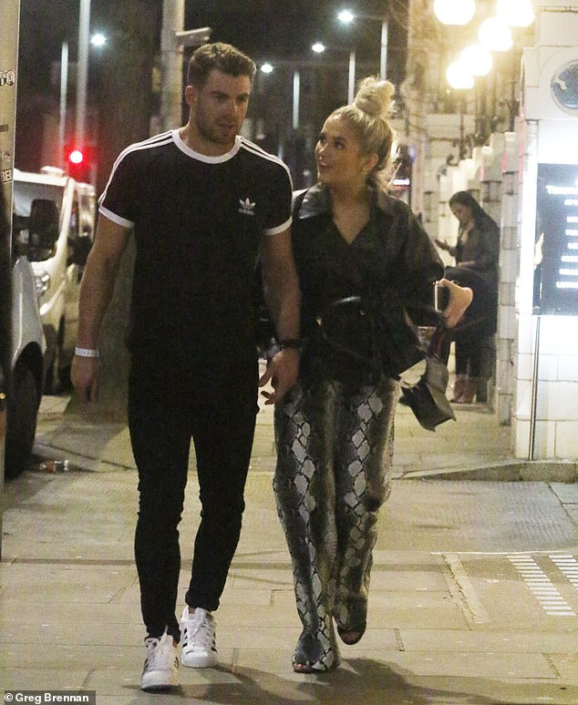 Stepping out: Bradley Simmons was spotted on a night out with a blonde beauty on Sunday, mere hours before training rumoured love out Caroline Flack at the gym