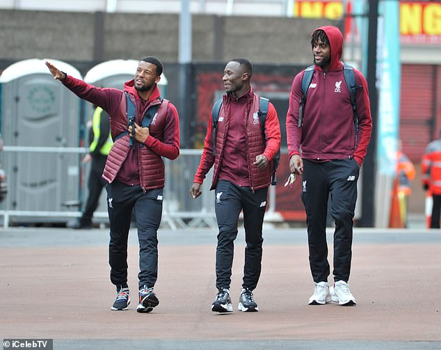 Georginio Wijnaldum chats with Naby Keita and Divock Origi ahead of the game