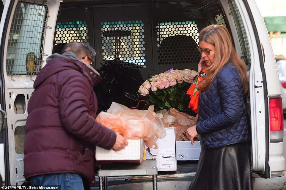 Gifts? A man and a woman were seen getting several different flower arrangements out of the back of a van, including a large bouquet of pink roses, which quickly sparked rumors that Meghan is expecting a baby girl