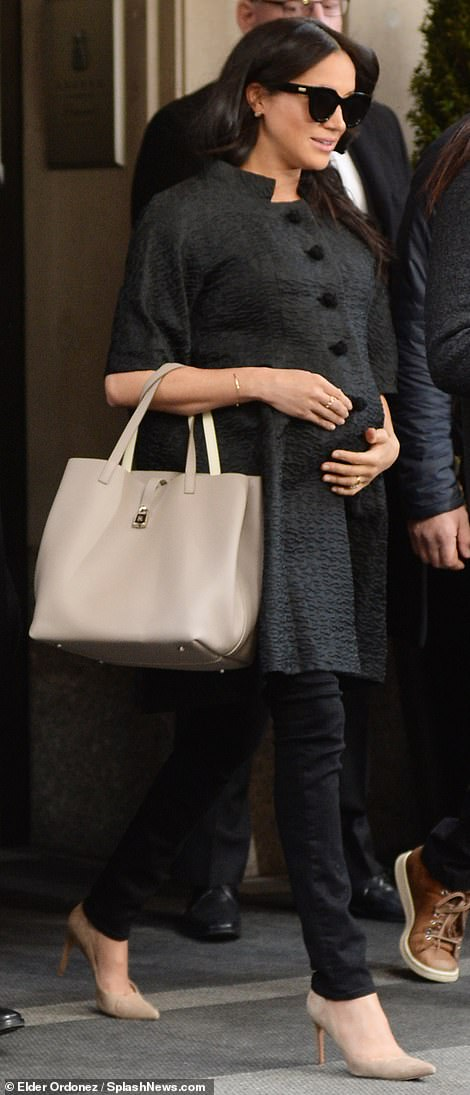 Mother-to-be: The seven-months pregnant royal wore a chic gray coat, black jeans, and nude heels as she made her way out of The Mark hotel on New York's Upper East Side, surrounded by plain clothes officers, hotel security, and staff