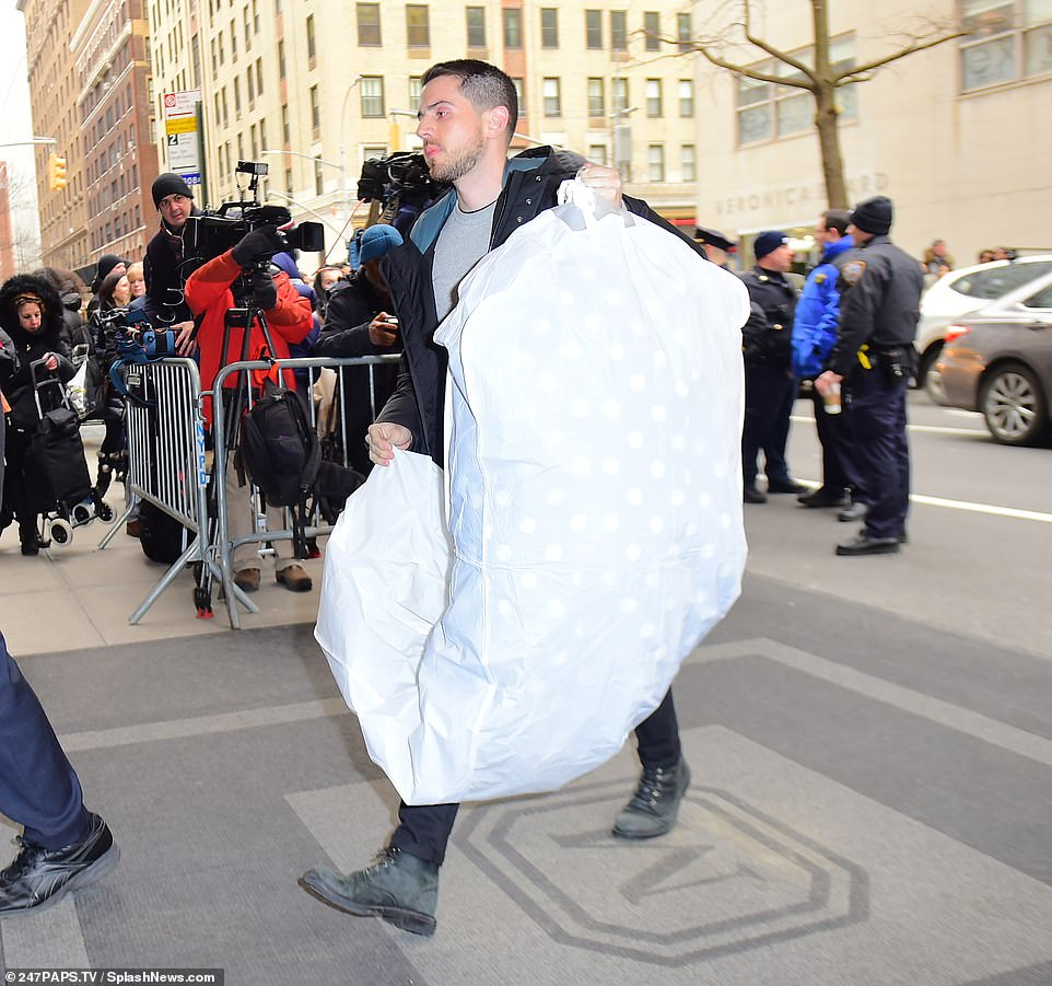 Something special? A large garment bag was one of many deliveries seen being made to the hotel ahead of the baby shower