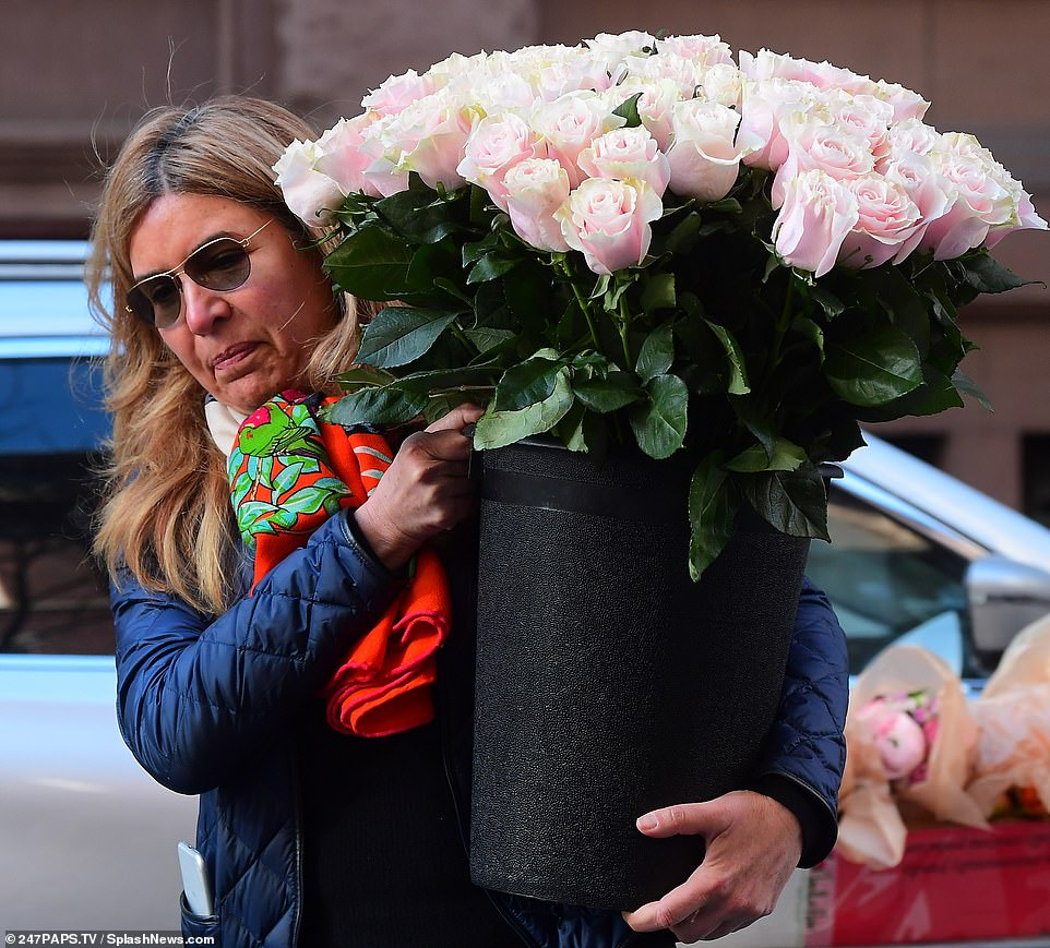 Special delivery! Her arrival comes shortly after a huge bucket of pink roses was seen being delivered to The Mark on Tuesday afternoon, ahead of Meghan's lavish baby shower