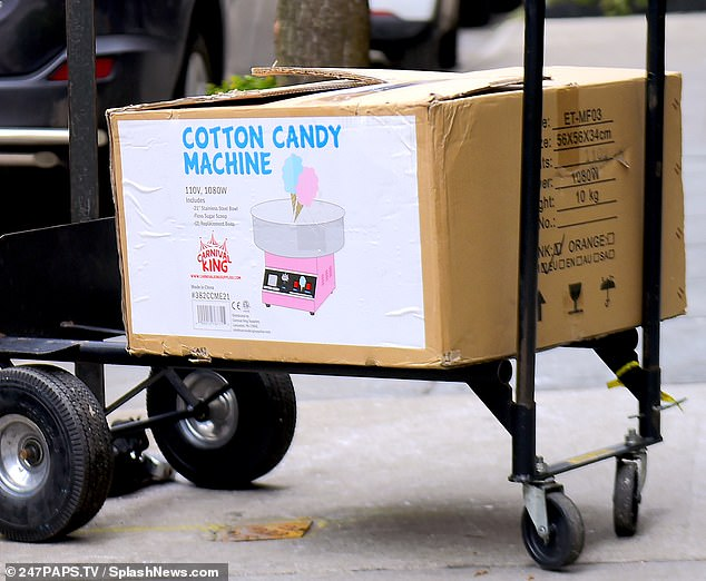 Sweet treat: A Carnival King cotton candy machine was also spotted being delivered to the hotel on Wednesday ahead of the shower