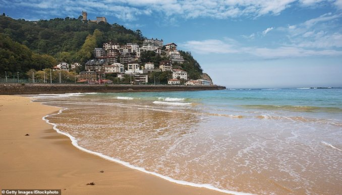 The highest rated beach in Europe according to TripAdvisor is La Concha Beach in San Sebastian on Spain's northern coast. It's located in the centre of the city and boasts more than 4,000 feet of white sand, plus there's a small island - Isla Santa Clara - in the middle of the bay. Beachgoers at La Concha can swim out to the island, which has its own small beach, lighthouse, picnic tables and bar. One traveller simply describedLa Concha as 'stunning', adding: 'We've just returned from a two-night break in San Sebastian and La Concha beach was one of our highlights! This beach is stunning, extremely clean, toilets available at different points and not an overflowing bin in sight! It's not to be missed'