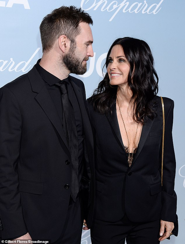 Gooey-eyed:Courteney Cox looked lovingly at beau Johnny McDaid on Thursday night as the couple stepped out for a gala event in Hollywood