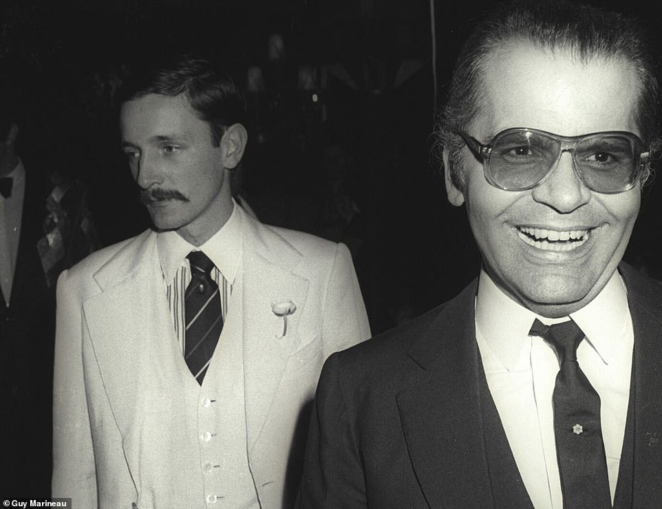 Companions: Jacques De Bascher wears a white jacket and waistcoat, as he accompanies his partner Karl Lagerfeld, wearing a black three-piece suit, in a photo believed to have been taken in the 1980s