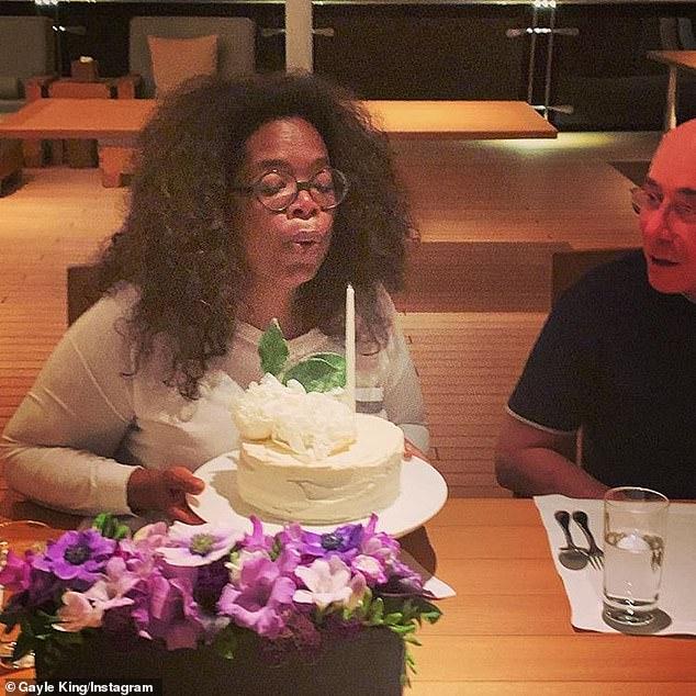 Major milestone: Gayle helped Oprah ring in her 65th birthday last month