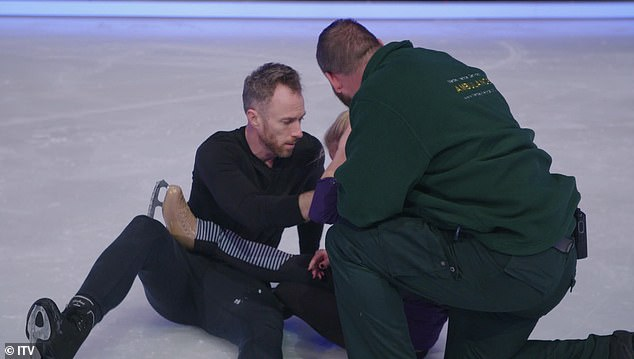 Concerned:A horrified James was seen looking deeply concerned for Alexandra as paramedics rushed onto the ice to help.