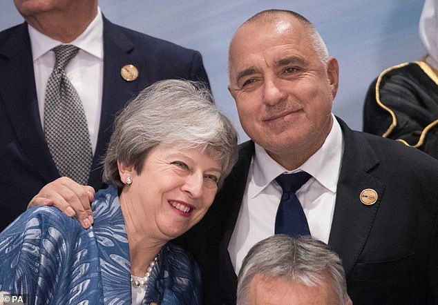Prime Minister Theresa May is hugged by the Prime Minister of Bulgaria Boyko Borissov