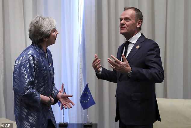 Mrs May met European Union Council President Donald Tusk, right, on the sidelines of the summit yesterday