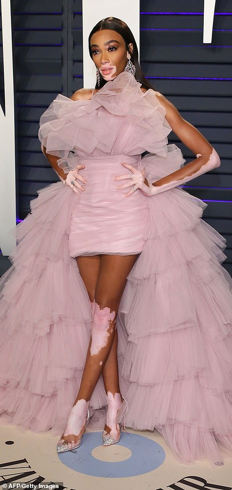 Wild: The front of her dress was mini in style and showed off her supermodel legs