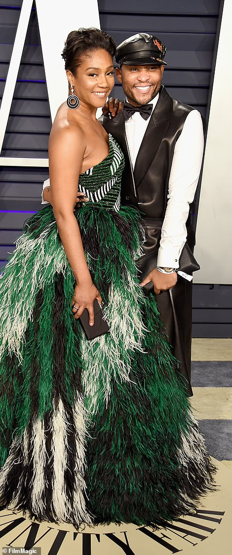 Powerful pairing: She posed alongside Celine Dion's stylist, Law Roach, who must have put her look together for the evening
