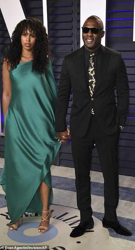 A dream in green: Idris Elba and Sabrina Dhowre made a very handsome couple as they held hands with one another