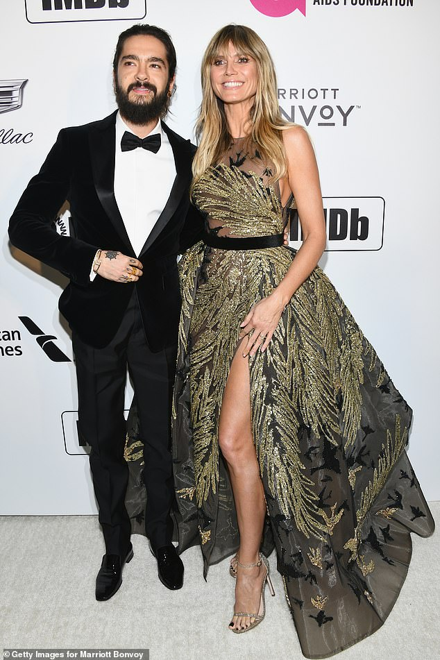 Stunning: Earlier in the night, catwalk queen Heidi was the very definition of glamour as she joined fiance om Kaulitz at the Elton John AIDS Foundation Academy Awards Viewing Party