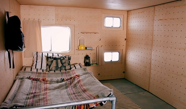 One half of the expanded cabin can be used as a bedroom with a double bed, pictured. There is a set of single bunks that can be pulled down from the walls for additional sleeping room