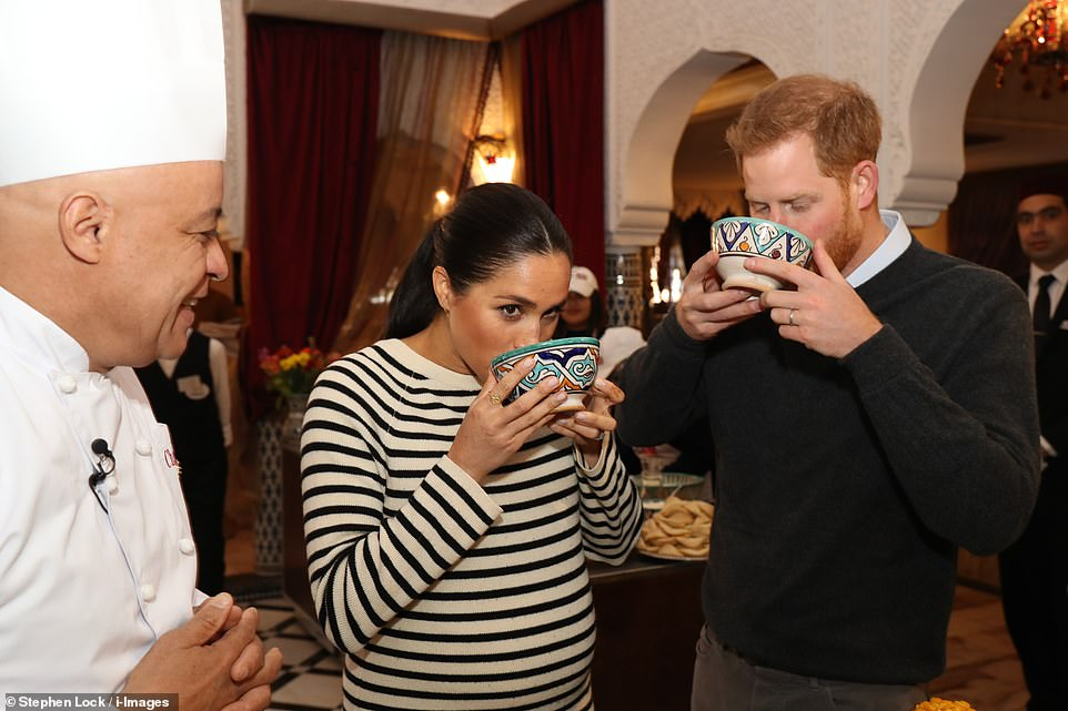 The couple could also be seen drinking a traditional concoction the chef had prepared out of small bowls during their visit