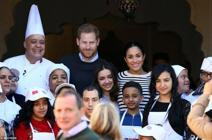 The couple posed with a group of school children after taking part in a cookery demonstration earlier today
