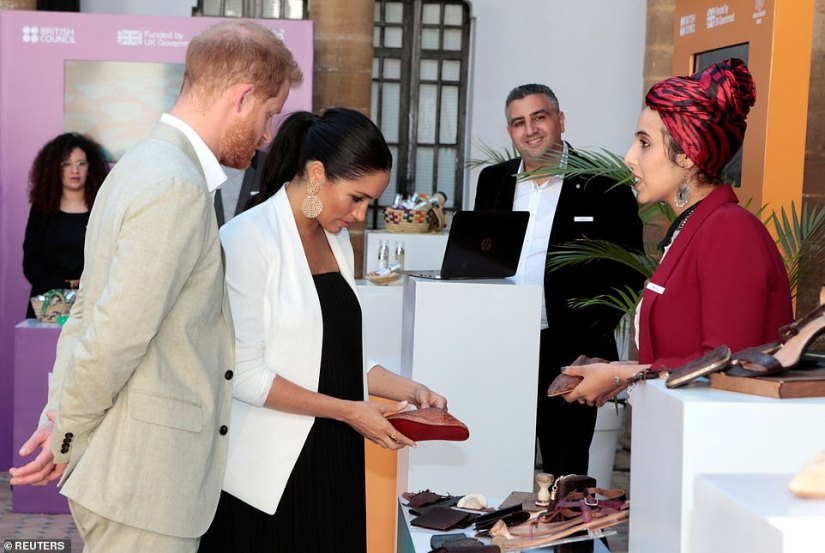 Meghan appeared to have her eye on some locally made shoes as she and Harry toured the Social Entrepreneurs event and market in the Andalusian Gardens on their final day in Morocco