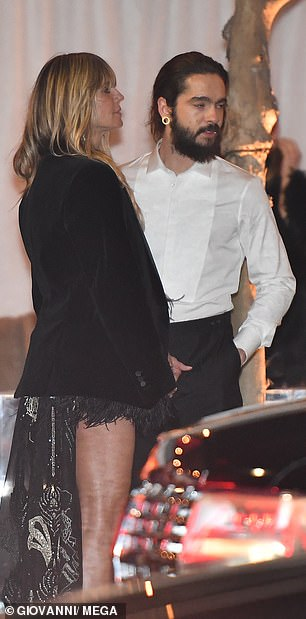 Cosy: The pair couldn't seem to tear themselves away from another as they left the bash