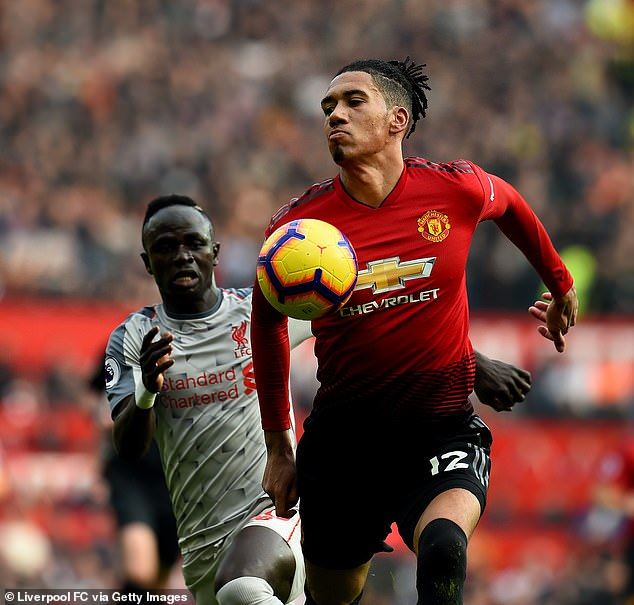 Smalling (right) played the full 90 minutes against Sadio Mane (left) and Co on Sunday