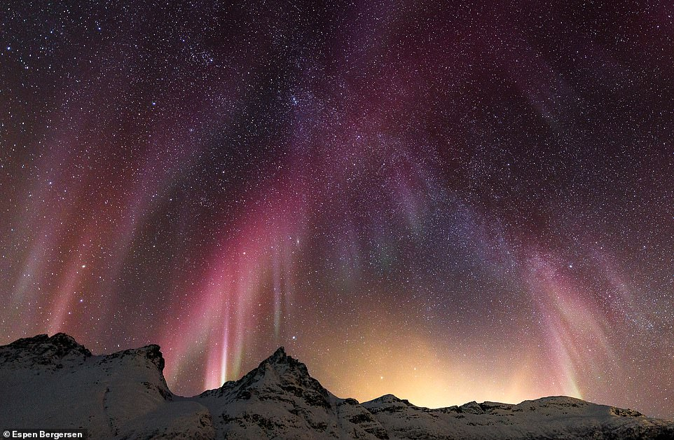 In this jaw-dropping shot, Espen caught the aurora blending in with the milky way. He says: 'Red and violet colours are much rarer compared to the greens and they are also more difficult to see with the human eye. Modern cameras are more capable of capturing these colours but the images will never match what you witness in real life'
