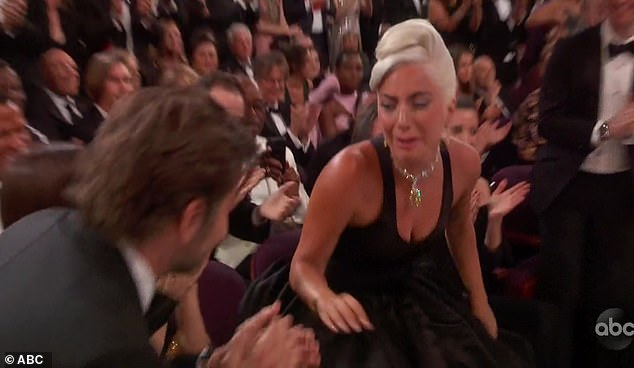 I did it! Lady Gaga turned to Bradley, leaning over Irina to celebrate after her name was announced for Best Song