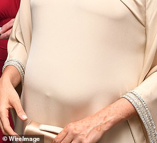 Meghan arriving at the British ambassador to Morocco's residence in Rabat, Morocco. The Duchess of Sussex had her hand tattooed with henna during a visit oif Morocco's high Atlas Mountain region