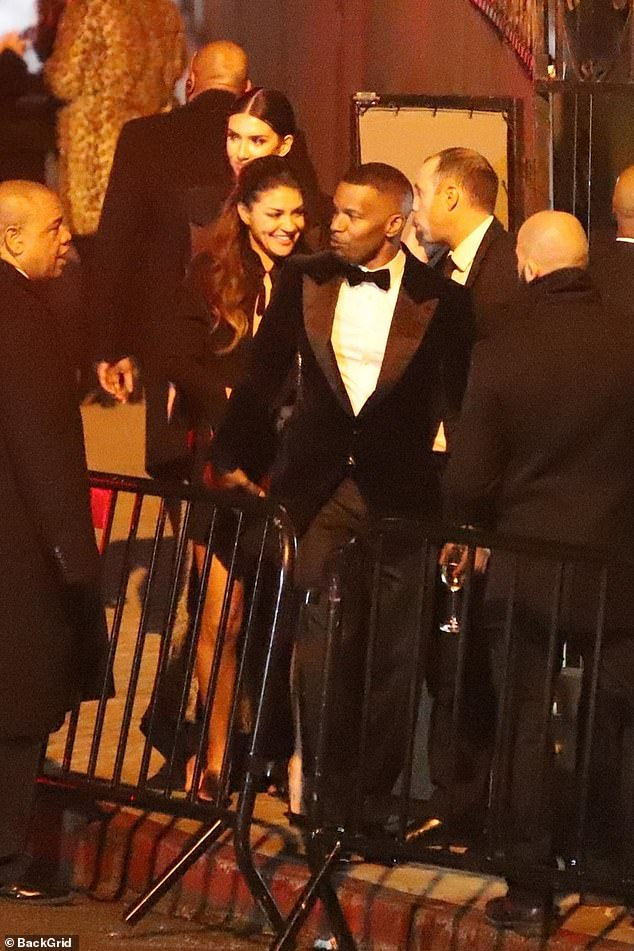 Cozy: Jamie Foxx, 51, attended Beyoncé and Jay-Z's ultra-exclusive post-Oscars party at West Hollywood's Chateau Marmont with 33-year-old actress Jessica Szohr; pictured February 24