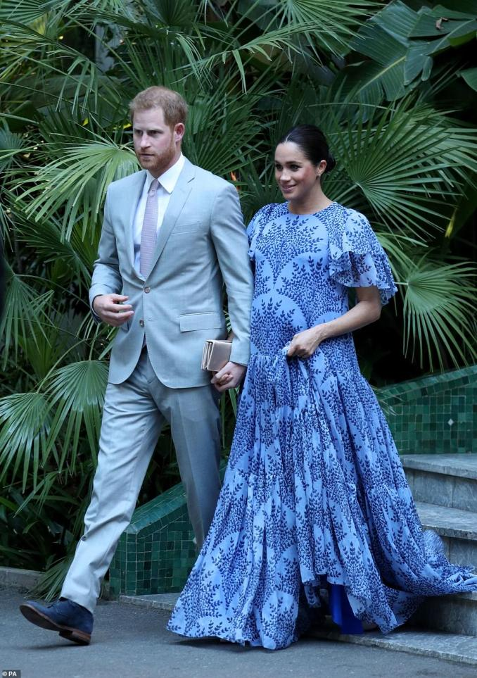 Fashion finale!Meghan, who is around seven months pregnant, wore a flowing blue dress with frilled sleeves at the Moroccan monarch's residence in Rabat on Monday evening, marking the end of the couple's three-day tour of the north African country