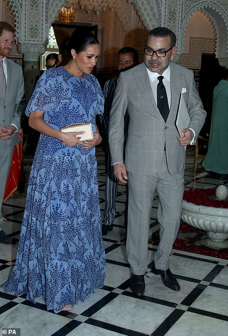 Meghan, who is around seven months pregnant, wore a flowing blue dress with frilled sleeves at the monarch's residence in Rabat on Monday evening.