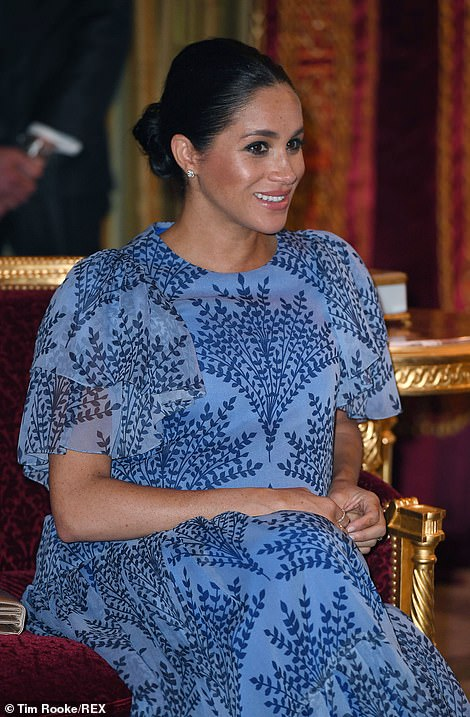 The Duchess of Sussex pulled her hair back into a tight bun and kept her makeup to a minimum