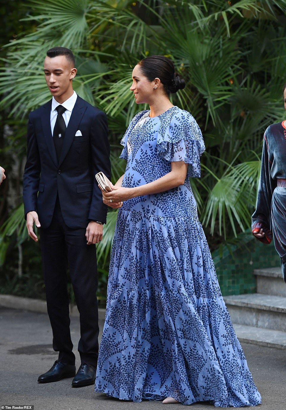Meghan's bump was on full display in the flowing Carolina Herrera gown. The Duchess of Sussex recently revealed to a member of the public that her first child with Prince Harry is due in 'late April or early May'
