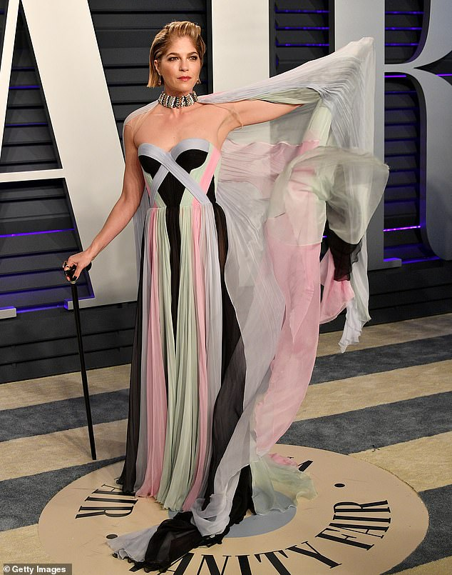 Beautiful: Selma looked stunning in a multi-colored dress by Ralph and Russo and a thick choker featuring an attached floor-length cape