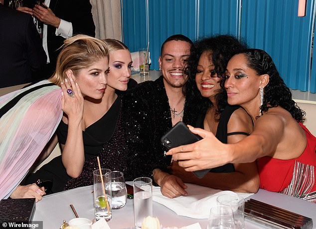 Fun times: The actress joked that she later 'pushed' her way into a family photo with Diana Ross, her childrenTracee Ellis Ross and Evan Ross, and her daughter-in-lawAshlee Simpson