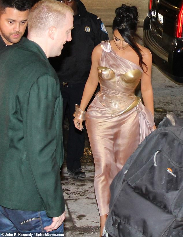 Proceed: Kim took trial steps in his heels six inches Yeezy as the paths were covered in a thin sheet of ice