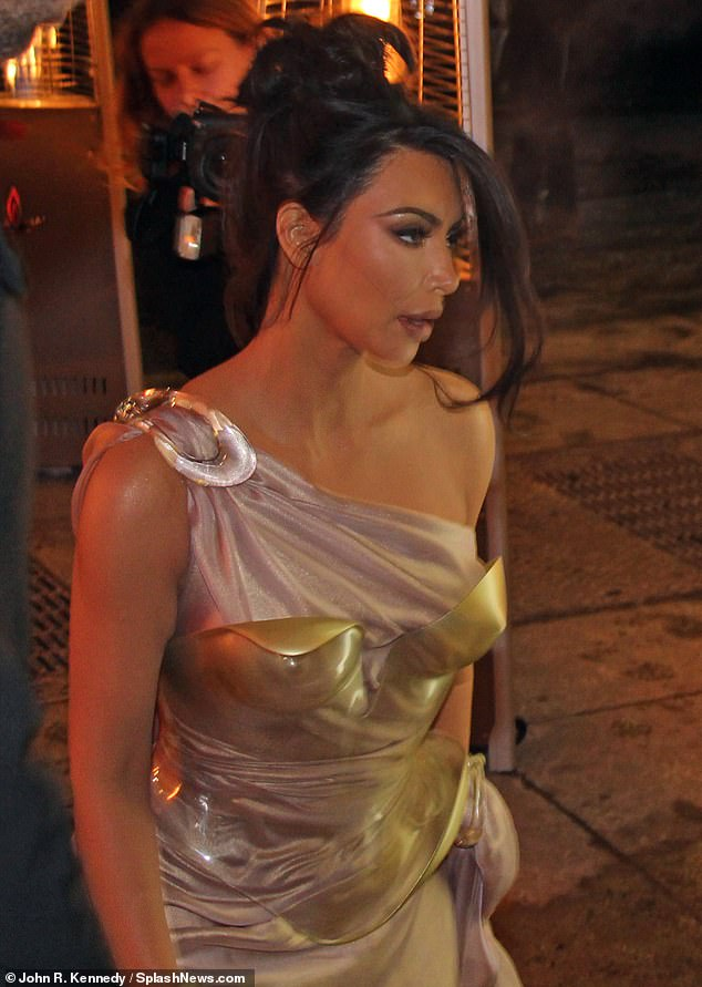 Uniform: There was a clasp above the individual shoulder in the pink dress and Kim showed no sign that it was freezing