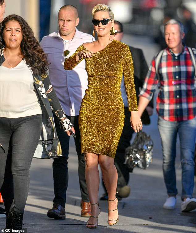 Figure-hugging: The 5ft7in pop singer rocked the body contouring dress as she walked up to Jimmy's studio next to the historic El Capitan movie palace