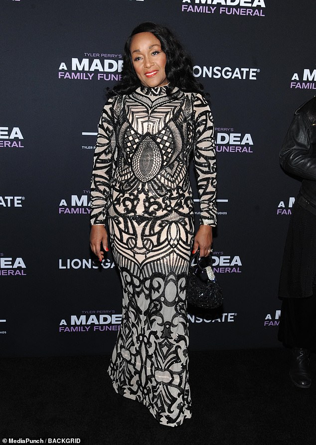 Classy: Jen Harper who is also in the movie opted for a full-length monochrome patterned gown with long sleeves