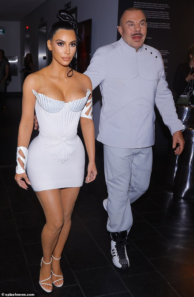 Personal tour guide: Thierry was seen to bring Kim into one of the various showrooms during the night