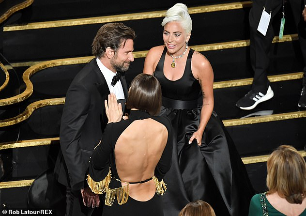 Happy for her: Later, when Gaga went up on stage to accept her Oscar for Best Original Song, she and Bradley were caught thunderously applauding for the Shallows singer