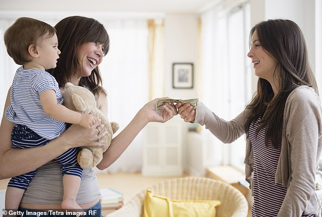 A mother handing money to a babysitter. The mother discovered her nanny had been breastfeeding her child when she got off from work early one Friday night. Stock image