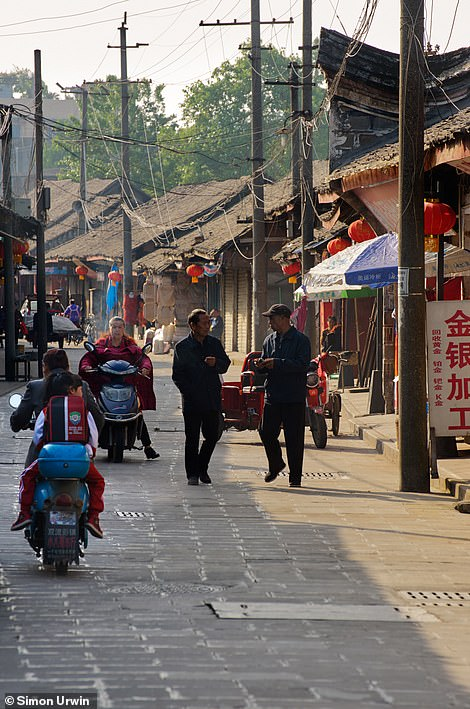 Pedestrians going about their everyday life in the deep western suburbs of Chengdu in China
