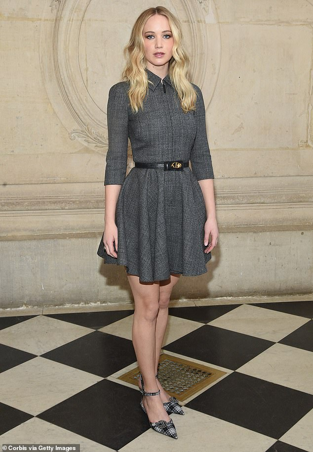 Elegant: The Silver Linings Playbook star looked chic in a charcoal grey tweed collared skater dress, which was belted at the middle to showcase her slim waist