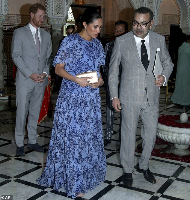 Pictured: Meghan with King Mohammed VI at his residence on the third and final day of their tour of Morocco on Monday evening. The couple left Rabat on Tuesday morning