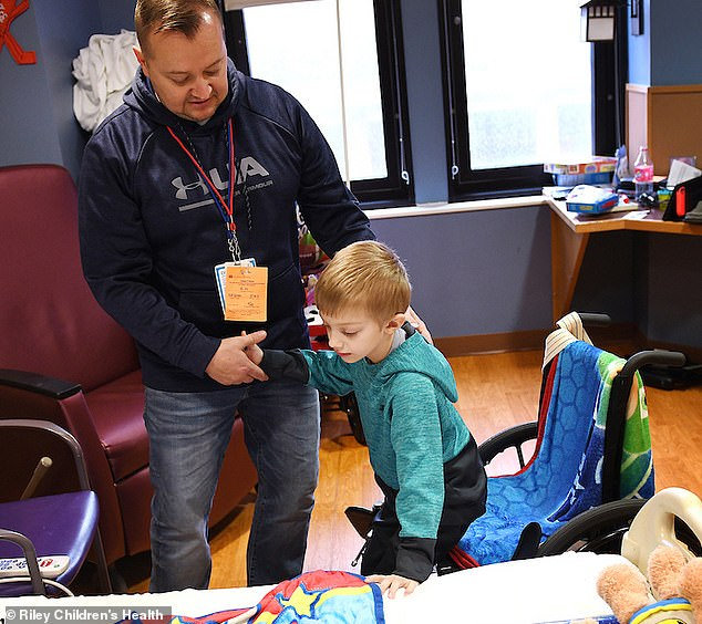 Guillain-Barré syndrome is a rare disorder in which the body's immune system attacks its peripheral nervous system, paralyzing parts of the body. Pictured: Brysen, right, during physical therapy with his father, Josh